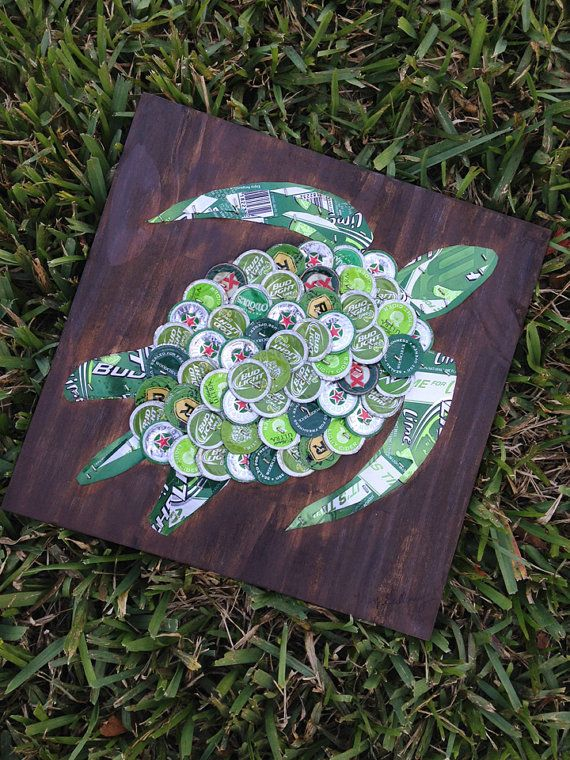 This piece has sold but I can make another one just for you!  This green sea turtle is made from nearly a hundred beer caps mounted on a 1/2 piece of painted wood painted. Beer caps include brands from Bud Light Lime, Woodchuck, Heineken, Smirnoff, Michelob Ultra Light Cider and many more. In addition, several Bud Light Lime beer can details head, legs and tail.  The design comes ready to hang. It is an original and is signed on the front and is titled and dated on the back. A great addition…