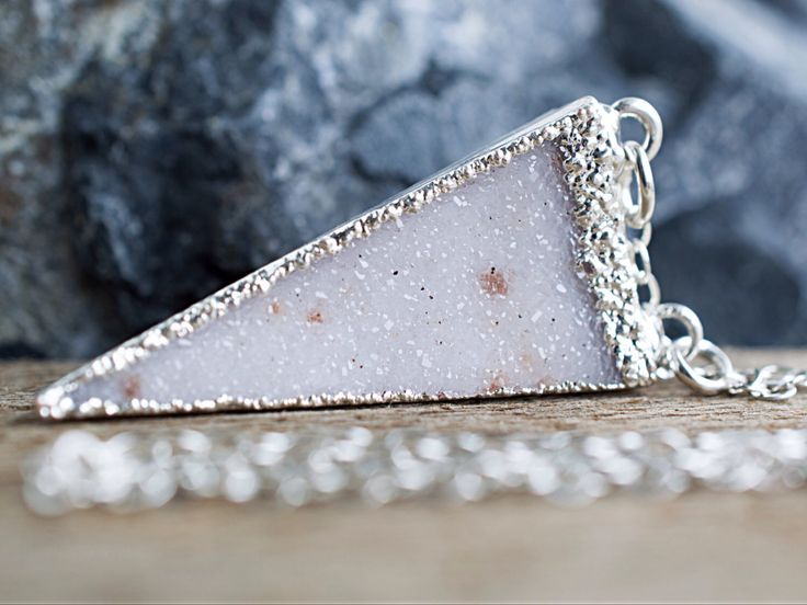 A personal favorite from my Etsy shop https://www.etsy.com/listing/227590968/white-druzy-triangle-necklace-long-druzy