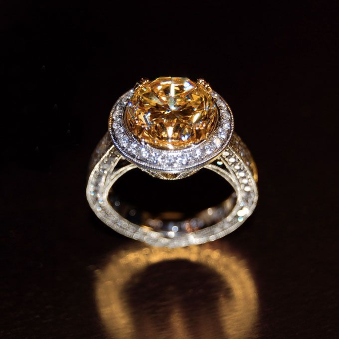 Brides.com: Celebrity Engagement Rings and Wedding Bands. Carrie Underwood's Engagement Ring  The American Idol winner wears a flawless, yellow diamond ring by Johnathon Arndt. See more over-the-top engagement rings.