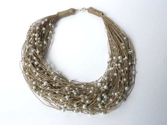 I'm in love with this necklace. It's nest like and pearl. So romantic yet earthy.