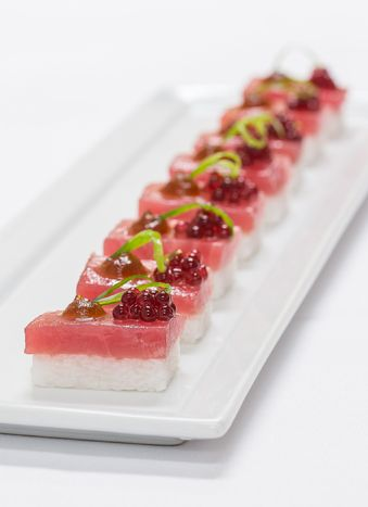 """Tuna sashimi on kaffir-lime-scented rice with hibiscus """"caviar,"""" by BG Events and Catering in Boston. Photo: Gary Tardiff for BizBash"""
