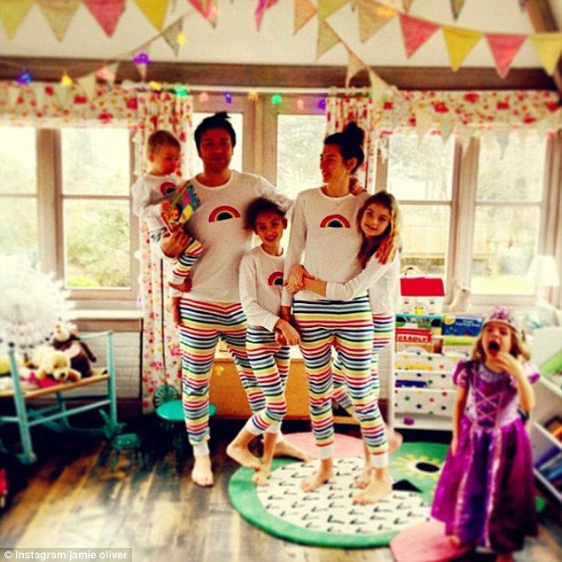 Pyjama party! The whole Oliver family poses for a photo wearing matching customised stripey nightwear designed by Jools for Mothercare