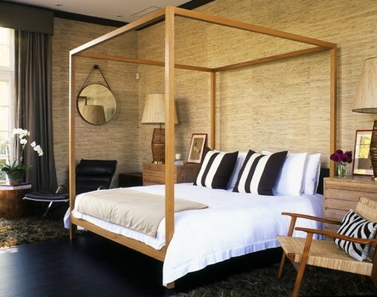 I'm in love with this bedroom.  Gorgeous wooden canopy bed, beautiful natural grasscloth wallpaper, midcentury chair.  Lots of woods, and textures going on. Fabulous ceiling height!