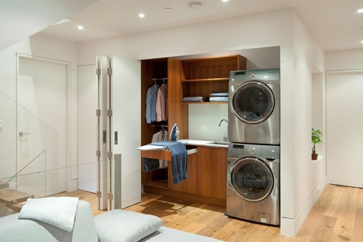 Ideas. Effective Stackable Washer And Dryer Laundry Room Organization Ideas. Sophisticated Hidden Laundry Room And Closet With Wooden Cabinet And Stacked Silver Washer And Dryer Featuring Foldable Door System Ideas.