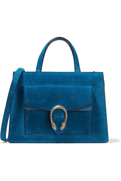 Gucci's 'Dionysus' tote is named after the god from Greek mythology - its gunmetal tiger head spur closure is inspired by the legend that he crossed the river Tigris on a tiger sent by Zeus. This sumptuous petrol suede version has a leather-trimmed envelope pocket and is neatly structured with three spacious internal compartments. Carry yours by the top handles or detachable shoulder strap.