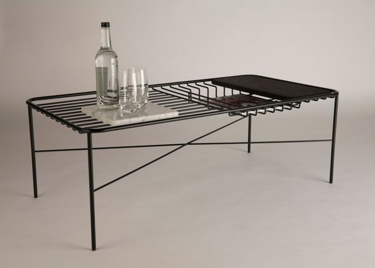 This coffee table created by Northumbria University graduate George Riding comes with a series of objects that integrate the table in a perfect way. Get comfortable and meet George Riding's Unique Wire Coffee Table Allows Integrated Objects!  More at: http://centertables.net/george-riding-unique-wire-coffee-table-allows-integrated-objects/