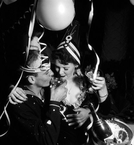 A sailor and his gal celebrate New Year's in full festive style. #vintage #1940s #New_Years