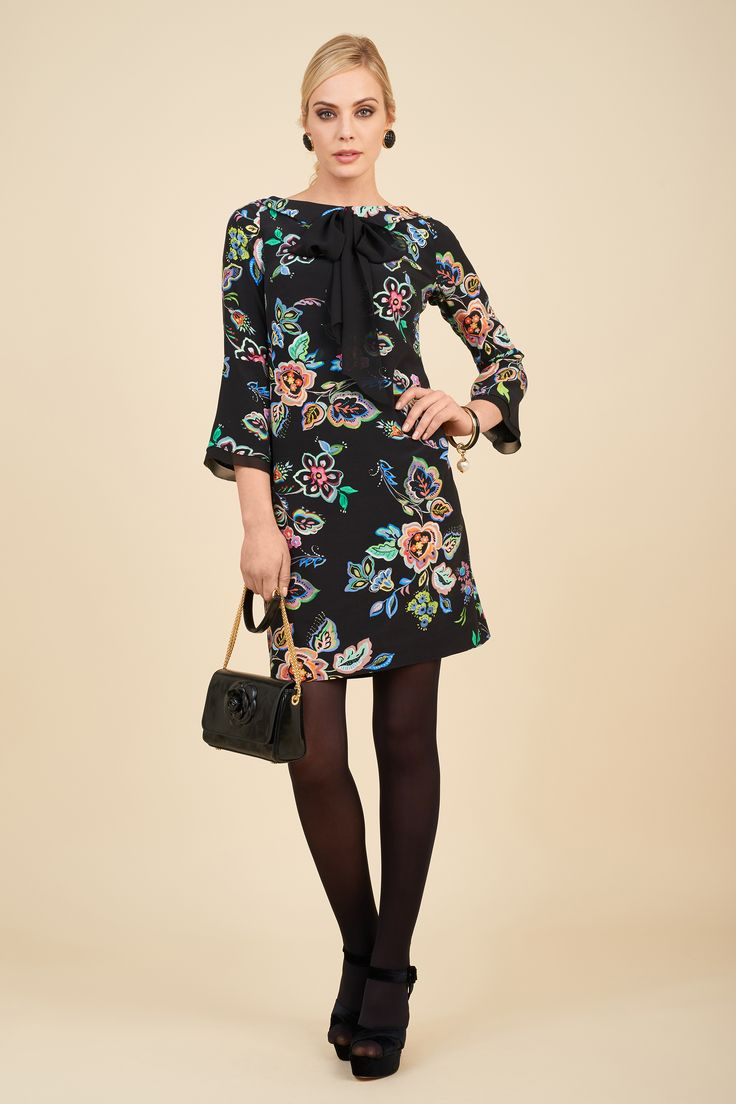 Printed dress with Isole bag.