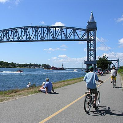 """Best Coastal Bike Trails: Cape Cod Rail Trail, Massachusetts: The Cape Cod Rail Trail in southeastern Massachusetts is the ultimate New England experience. As you ride the 22-mile rail-trail through villages from South Dennis to South Wellfleet, you'll roll past cranberry bogs, beaches, and plenty of places to """"pahk"""" and..."""