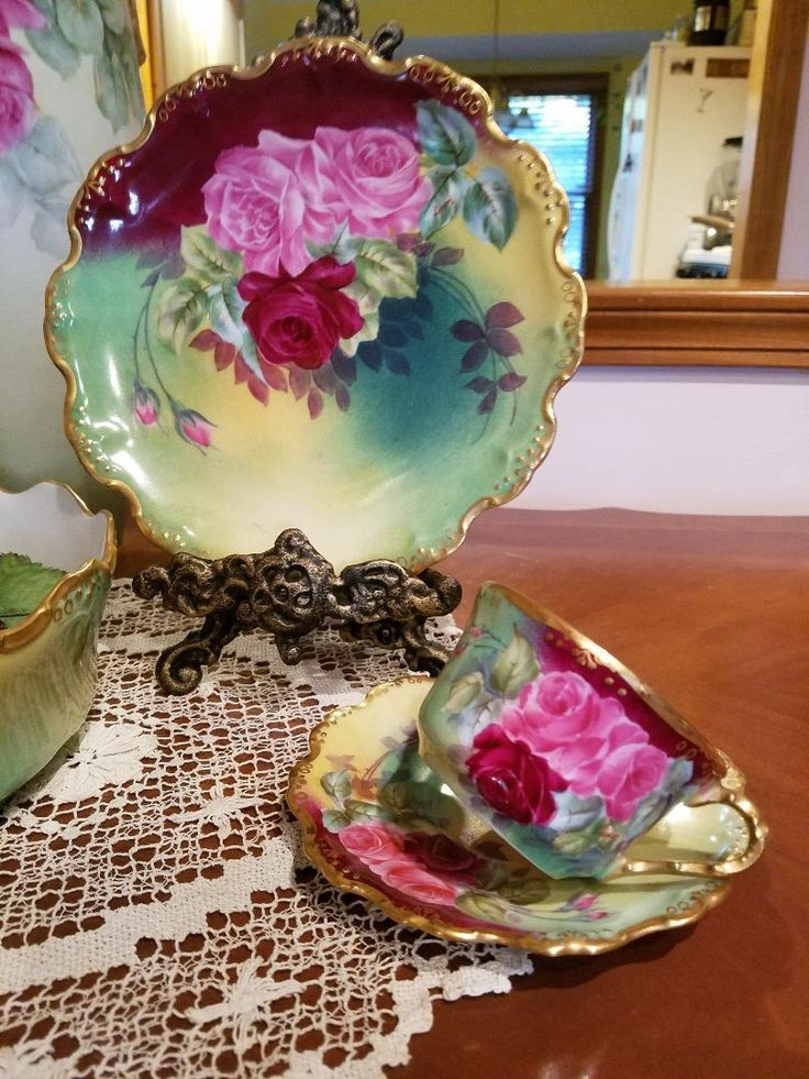 I am very pleased to offer for your consideration a Stunning Antique hand painted Rose Cup Set bearing 2 Limoges Marks, Coiffe Mark 3 in green,Ca