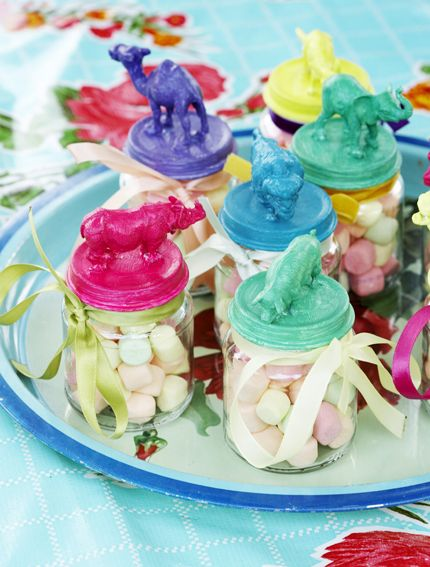 cute bottles with candies. could be done diy with mini dinos.