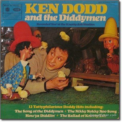 """Unintentionally Terrifying Children's Album Covers.  What are """"the Diddymen""""? Apparently little buck-toothed hunchback trolls with comically oversized hats, the weight of which has ruined the curvature of their spines. What's most unsettling about this is we're pretty sure this image represents what Ken Dodd sees all the time. The Diddymen are always there, aren't they, Ken?    Wait a second, is the Diddyman on the far left making that chick blow him?"""
