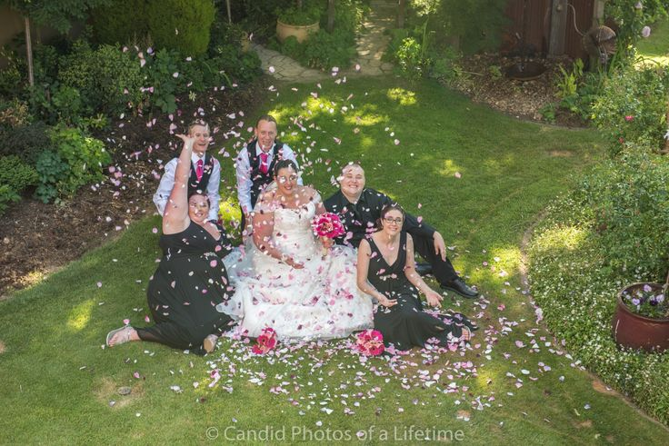 Candid Photos of a Lifetime - Being showered with rose petals - Gairloch Garden, Oberon Gairloch Garden Oberon is the perfect location for wedding formals. www.candidphotosofalifetime.com.au