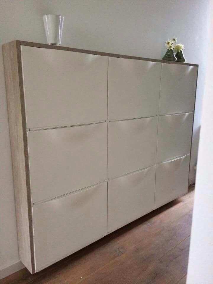 Schoenenkastjes van Ikea met plank er omheen afgewerkt