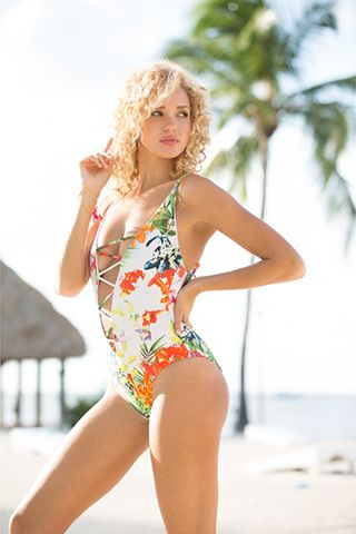 TETIAROA FLORAL ONE PIECE SWIMSUIT. Beautiful one piece swimsuit with sexy front. Ties at the back with pom pom detailing.