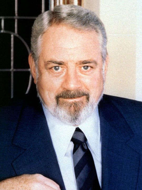 """Raymond Burr -- (5/21/1917-9/12/1993). Canadian-American Actor. He portrayed Title TV Series, """"Perry Mason"""", Herman Bockweiss on """"Centennial"""", R.B. Kingston on """"Kingston: Confidential"""", Robert T. Ironside on """"Ironside"""". Movies -- """"Perry Mason Returns"""" & """"The Return of Ironside"""", """"Airplane II: The Sequel"""" as Judge D.C. Simonton, """"Godzilla, King of the Monsters"""" & """"Godzilla 1985"""" as Steve Martin, """"Out of the Blue"""" as Dr. Brean and """"Delerious"""" as Carter Hedison. He died of Cancer, age 76."""
