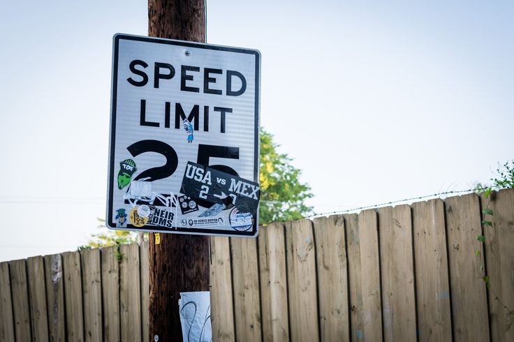 Speed limit sign with stickers in NoDa, Charlotte, North Carolina.