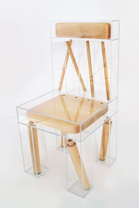 By Joyce Lin. A chair is dismembered and partitioned into clear plastic boxes. The superimposition of one chair form over another emphasizes both the joinery of its parts and the form as a whole, calling into question the idea/function of a chair versus its physical reality and ideas about material and permanence.