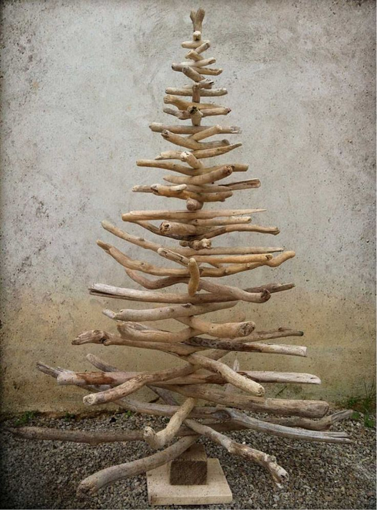 Interesting tree idea. Add some pine garland and some white lights.