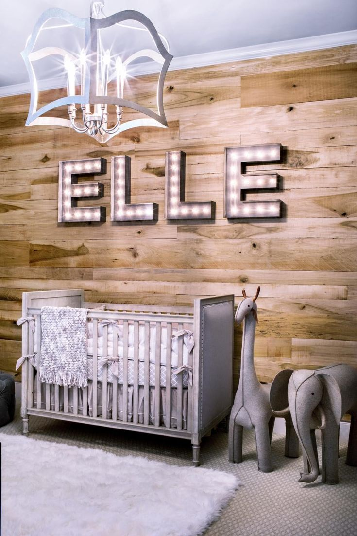 The lighting in Baby's room can be playful without being corny. Here, marquee letters spell out their little owner's name and a chic chandelier twinkles in the middle of the space.
