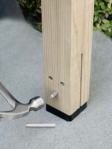 What a slick way to anchor a post in concrete and protect it from rot: Slip the kerfed end of a post over the bolted-down base, then tap three pins in place, just like a timber framer. | CPTZ Concealed Post tie, by @strongtie