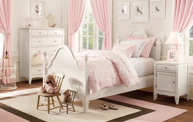 a bedroom for a young lady who loves pink white with a