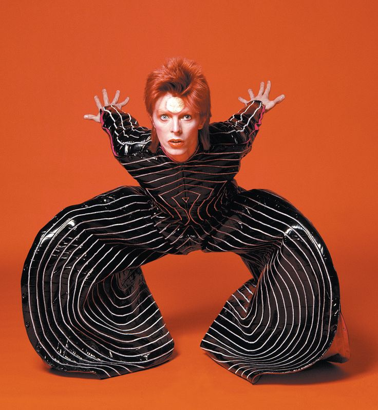 """Androgyny was central to Bowie's rising appeal—neither quite straight nor really gay, but something in between that cannot even be adequately described as bisexual. Yamamoto, the Japanese designer, said he liked to make clothes for Bowie because he was """"neither man nor woman."""" The image cultivated by Bowie, as he became more famous, was as a complete oddity, an isolated alien, a pop deity, utterly enigmatic, freakish, alienated, but dangerously alluring."""