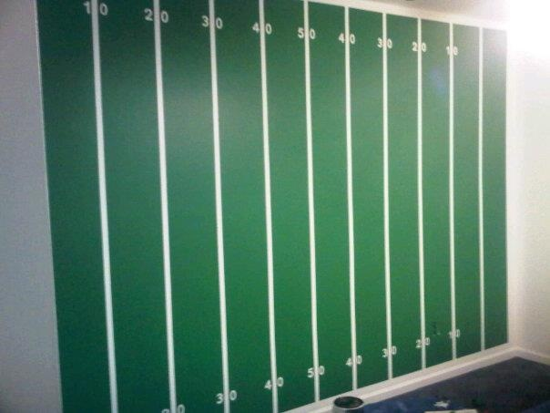 Football wall in Matthew's room. All painted by hand. I wish I had known the trick to perfect lines BEFORE I painted this wall!