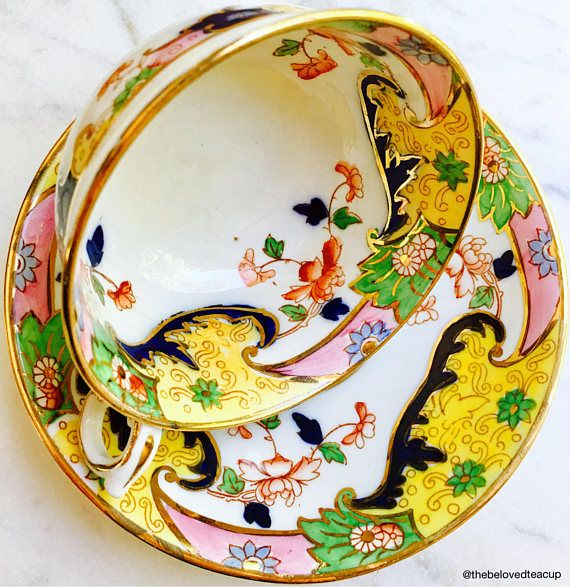 Stunning art nouveau pre 1910s Royal Stafford tea cup and saucer featuring elegant yellow, pink and green scrolls and intricate floral details. Set is in incredible antique condition for its age with no chips, cracks or major paint/gold wear.