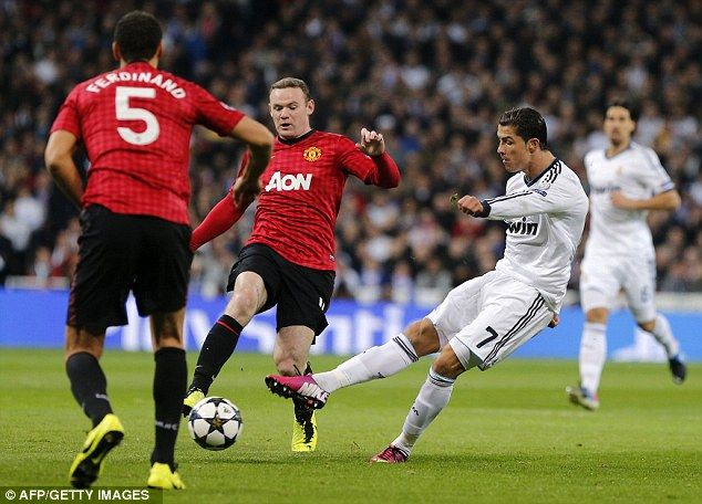 Manchester United's Wayne Rooney (left) attempts to track down Real Madrid's Cristiano Ronaldo