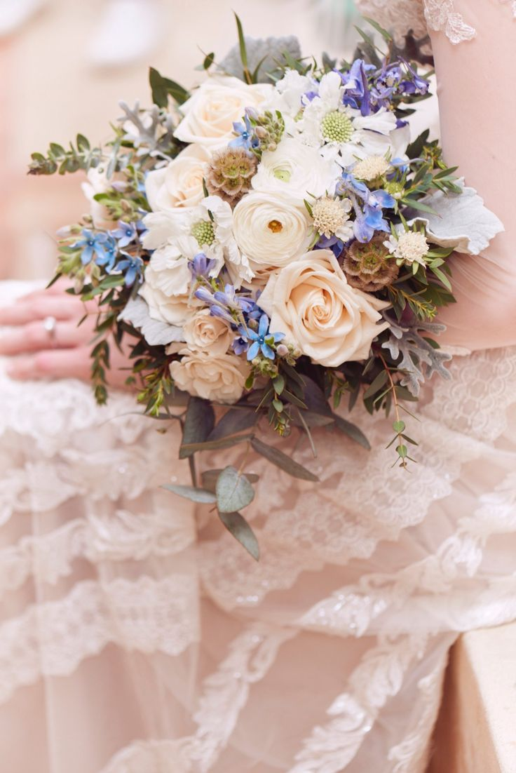 Soft blue and bright white wedding flowers courtesy of our romantic Melissa Sweet wedding dress shoot!