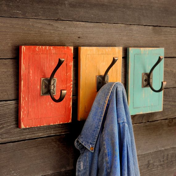 This bunk house coat hook set will add a touch of color to any entryway! This listing is for a three (3) piece set. Great for adding pops of color to hallway or entrance area. Sizes: Individual Hook 6 W x 8 H x 3.5 D Group of 3 as shown 20 W x 8 H x 3.5 D  Colors Shown: Chimney Brick Orange, Historic Yellow, Gulf Blue  You can customize this selection! Pick any three colors from our 27 color palette and add it to the message to the seller box when ordering. You may also choose one color…