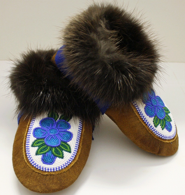 $375. Moosehide moccasin slippers with floral beaded design with blue melton cuff with Beaver fur. Made by Rosa Wedzin from Behchoko NT.
