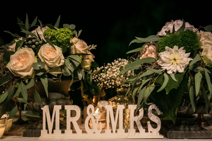 """Mr & Mrs"" are surrounded by eucalyptus, roses, baby's breath and dailies! :-)"