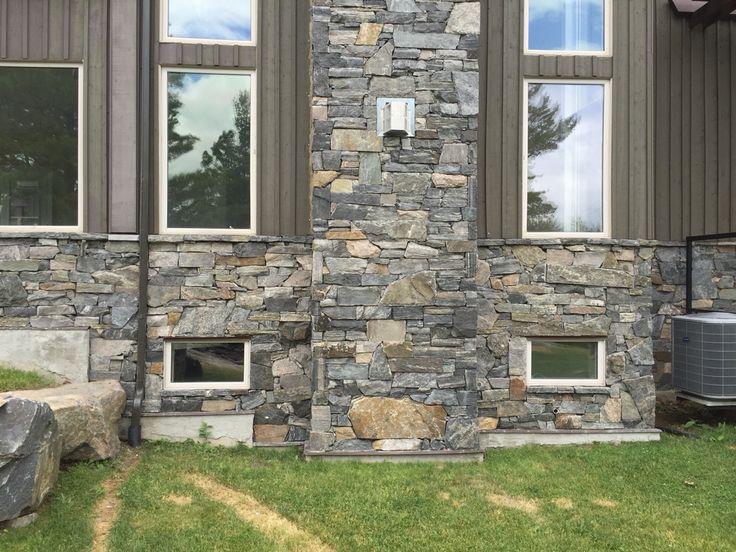 Muskoka granite. Very messy rubble wall drystacked. By: Saunders Stone Design