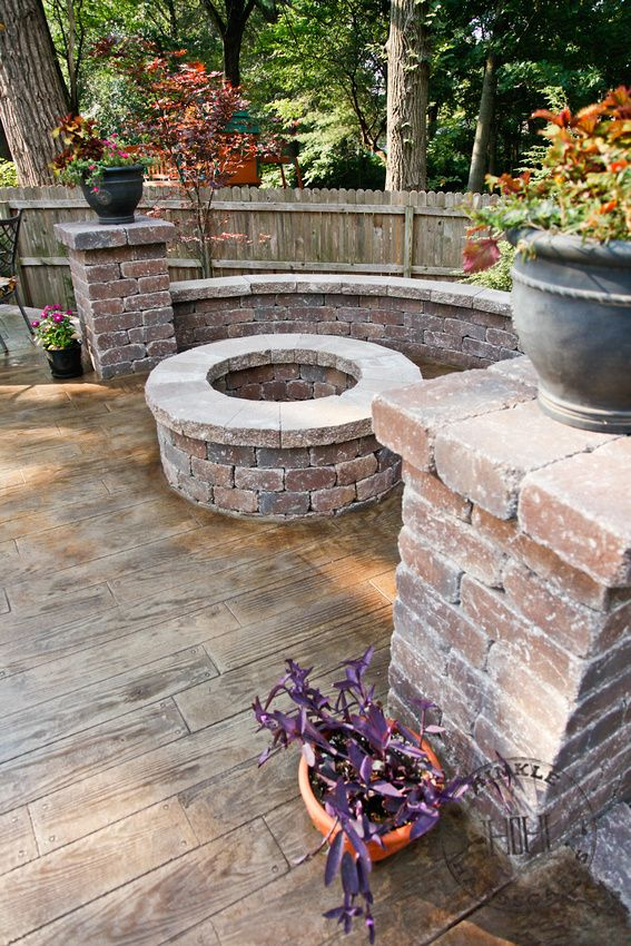 Love this fire pit and the stamped concrete to make look like wood