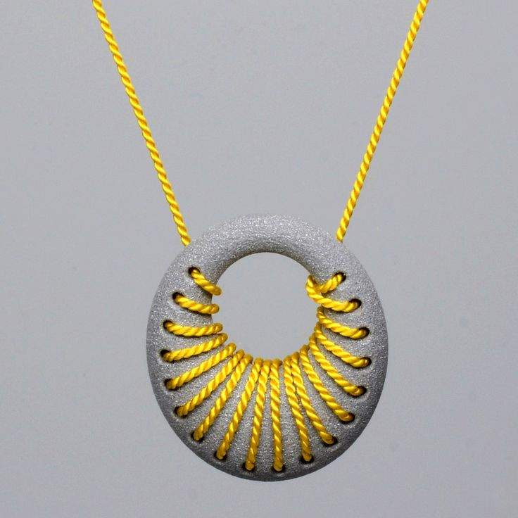Featured at SXSW 2013: 3D Printed aluminum loop pendant with silk cord woven into the design