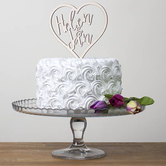Our heart wedding cake topper can be personalised with 2 names; perfect for a wedding, engagement party or even an anniversary. You could even use it for all three!  Having a rustic style wedding or a vintage themed celebration? Order this cake topper in birch for a beautiful and natural finish. Have a specific colour in mind to match your theme? Choose from a wide range of coloured acrylics.  This can be carefully cleaned after use and of course it can be kept as a special memento long…