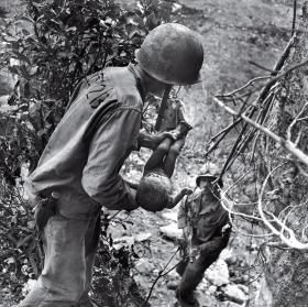 World War II Battle of Saipan photographed by W. Eugene Smith 1944.