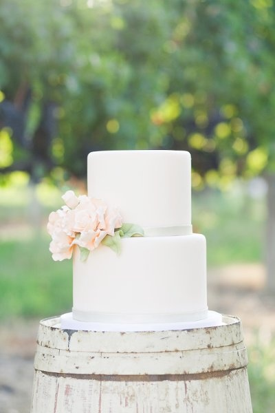 two-tier cake--purple ribbon with Yellow or orange flowers?