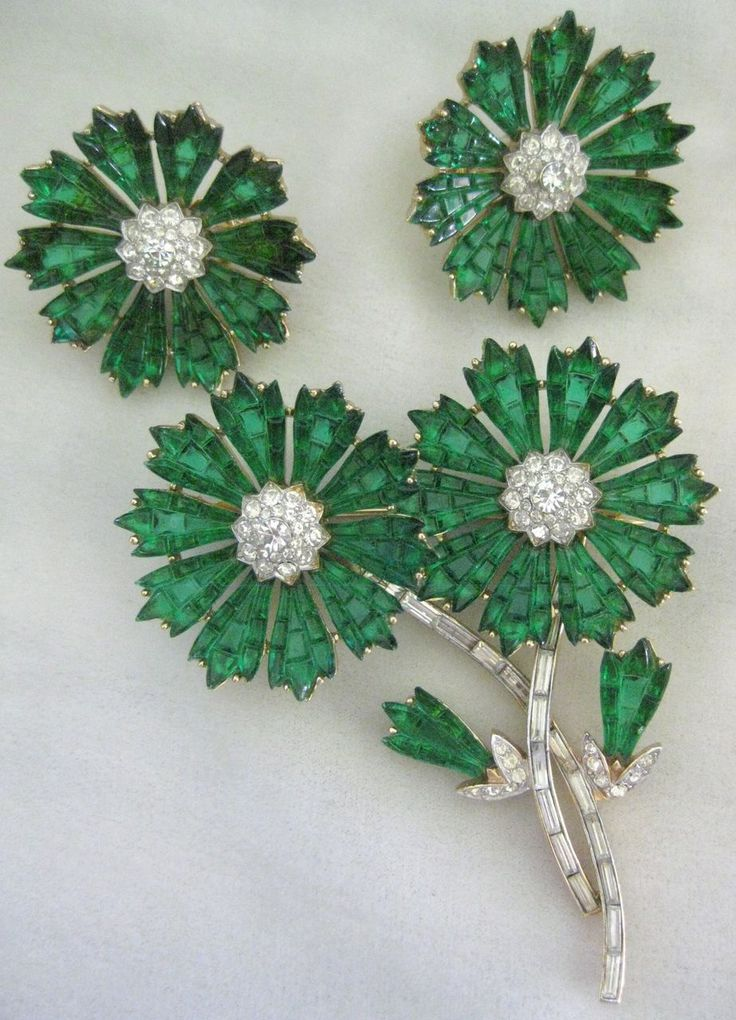 Rare Emerald Glass Invisible Setting Flower Demi Parure TRIFARI from vintagejewelrytoo on Ruby Lane