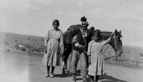 Apache man, woman and their daughter
