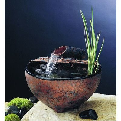 Found it at Wayfair - Ceramic Nature Bowl Tabletop Fountain This is the artist I was trying to find earlier.  His fountains range between $230 and $380 in price.