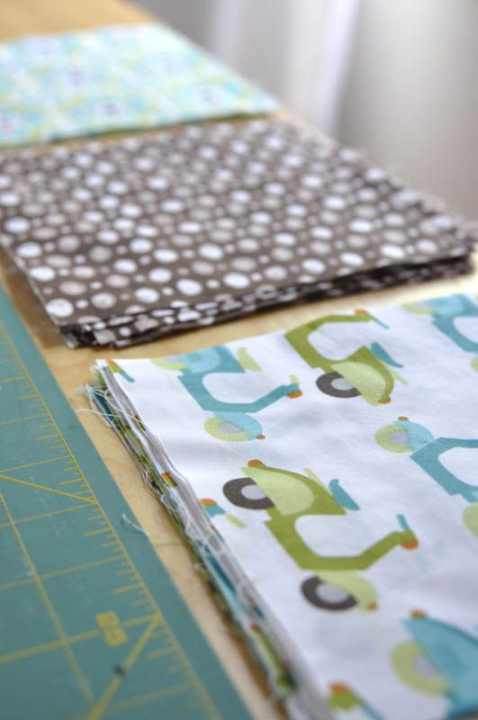 """simple baby quilt tutorial - 42""""X48"""" - 56 squares - 6 1/2"""" Squares (2 packages of bundled squares at Jo-Ann Fabrics), 1 or 2 packages of edging, 1 string of embroidery yarn, and batting for the inside."""