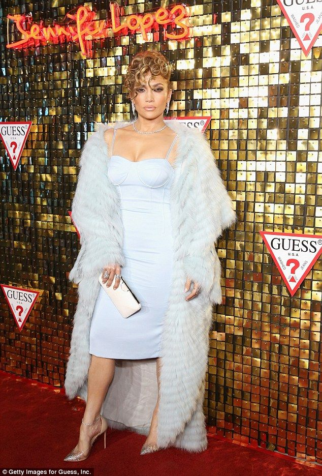 Star: Jennifer Lopez put on a busty display in a very pale blue strapless dress with a mat...