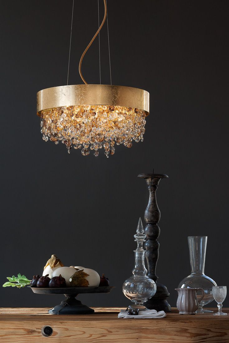This large modern ceiling light includes a gold leaf frame, draped with a series of amber coloured Italian crystal pendants. Add a touch of style and glamour with the Gold Leaf Amber Coloured Crystal Modern Chandelier. This exclusive range of lighting offers unique contemporary designs along with superior quality! #luxurylighting #goldchandelier #designerlighting