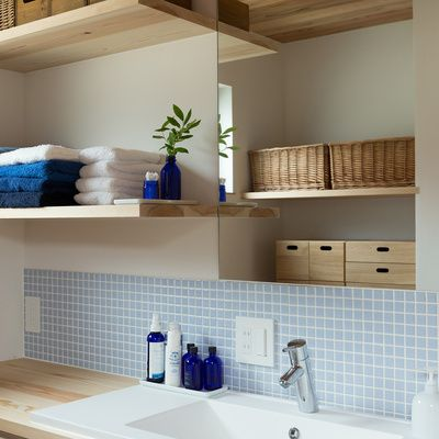 Bathroom: Pale blue and wood elements