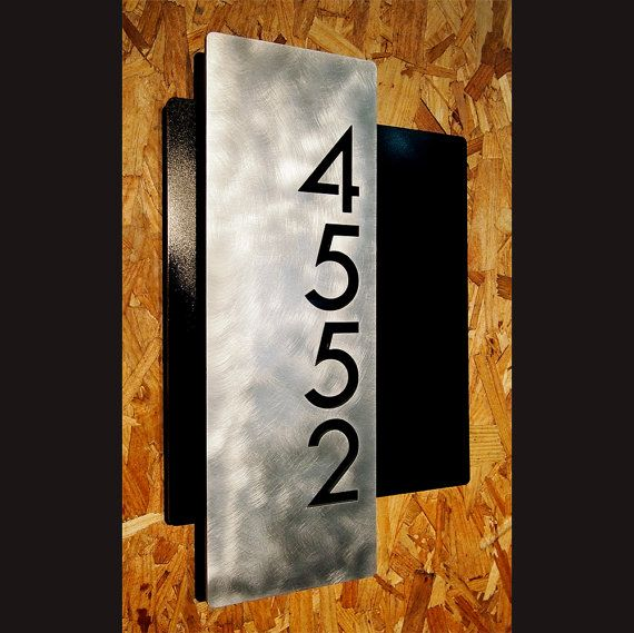 Custom Modern Layered Floating House Numbers Vertical Offset in Aluminum The Modern and Sleek house number sign made from 1/4 aluminum. For 3-5