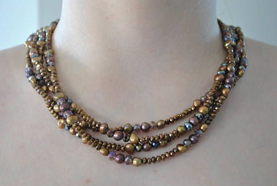 Bronze Four Strand Pearl & Crystal Artisan Necklace #necklace #four #fourstrand #artisan #handmade #pearl #potatopearls #faceted #crystals #facetedcrystals #bronze #gold #mauve #plum #pearls #delicate #feminine #oneofakind #dressy #casual #iridescent