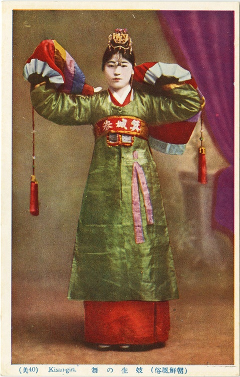 Kisan-girl, vintage postcard. Kisaeng are artists who work to entertain others, such as the yangbans and kings. First appearing in the Goryeo Dynasty, kisaeng were legally entertainers of the government, required to perform various functions for the state. Many were employed at court, but they were also spread throughout the country.